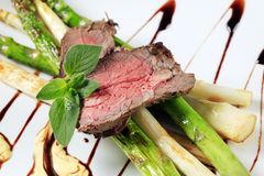 Roast beef and asparagus Royalty Free Stock Photo