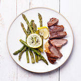 Roast beef with asparagus Royalty Free Stock Photo