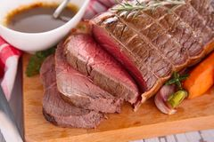 Roast beef on board Stock Images
