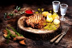 Roast beef and boiled potatoes. Roast beef with boiled potatoes and moonshine stock photo