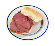 Roast beef bulky roll sandwich on plate Royalty Free Stock Images