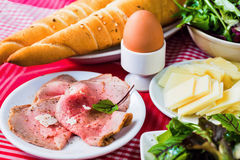 Roast beef, cheese, egg, lettuce and croissant Stock Photo