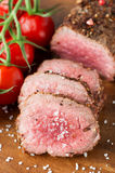 Roast beef with cherry tomatoes Stock Image