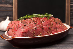 Roast beef closeup. Roast beef with rosemary and garlic prepared for frying stock photo