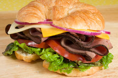 Roast Beef on a Croissant Stock Photo