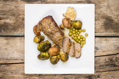Roast beef cut in slice with broccoli, brussels sprouts and mushrooms Royalty Free Stock Photo