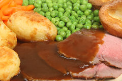 Roast Beef Dinner. Traditional British roast beef dinner with Yorkshire pudding Royalty Free Stock Photography