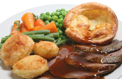 Roast Beef Dinner. With Yorkshire pudding, roast potatoes and vegetables Stock Image