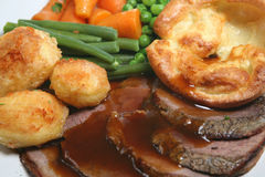 Roast Beef Dinner. Traditional British roast beef dinner with yorkshire pudding and vegetables Stock Photography