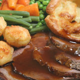Roast Beef Dinner. Traditional British Sunday roast dinner with beef and Yorkshire pudding Royalty Free Stock Photography