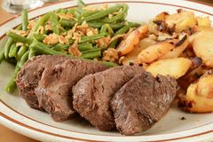 Roast beef and garlic potatoes Royalty Free Stock Images