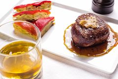 Roast beef with a glass of whiskey royalty free stock photos