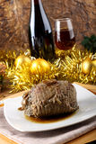 Roast beef with gravy. On Christmas background Royalty Free Stock Image