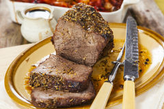 Roast beef joint with roast vegetables Royalty Free Stock Photos