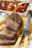 Roast beef joint with roast vegetables Royalty Free Stock Photography