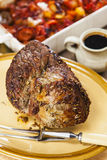 Roast beef joint with roast vegetables Stock Photo