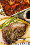 Roast beef joint with roast vegetables Stock Image