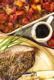 Roast beef joint with roast vegetables Royalty Free Stock Photo