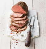 Roast beef and meat fork Stock Photo