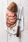 Roast beef and meat fork Royalty Free Stock Photography