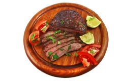 Roast beef meat slices on wood plate Royalty Free Stock Photos
