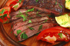 Roast beef meat with tomato Stock Photography