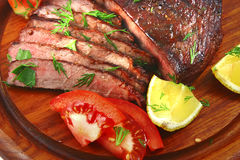 Roast beef meat with tomato Stock Photo