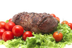Roast beef meat on vegetables Stock Photo