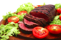 Roast beef meat on wooden plate Stock Photography