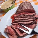 Roast beef. On orange tartan tablecloth Stock Images