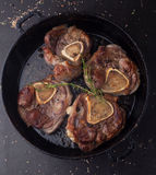 Roast beef ossobuco in a frying pan Royalty Free Stock Photography