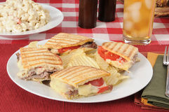 Roast beef panini with iced tea Stock Images