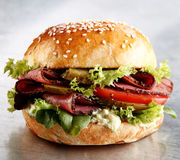 Roast beef or pastrami roll with salad trimmings Stock Photos