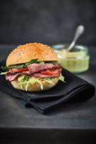 Roast beef pastrami sandwich with mustard in background Royalty Free Stock Photos