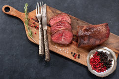 Roast beef with pepper and rosemary Royalty Free Stock Image