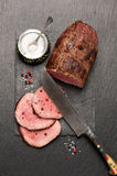 Roast beef with pepper and salt Stock Images