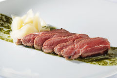 Roast beef with pesto sauce Stock Images