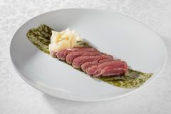 Roast beef with pesto sauce Royalty Free Stock Images