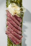 Roast beef with pesto sauce Royalty Free Stock Image