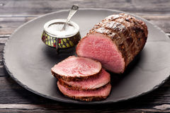 Roast beef. On a plate and salt Royalty Free Stock Photography