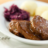 Roast beef with potato dumplings and red cabbage Stock Image