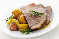 Roast beef and potatoes. Serving of roast beef and roasted potatoes meal stock photo