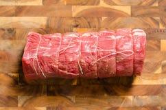 Roast beef. Raw roast best beef on wooden stock photo