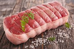 Roast beef. Raw fresh roast beef on wood Stock Photo