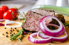 Roast beef with red onion rings Stock Image