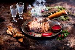 Roast beef. With smoke and moonshine stock photos