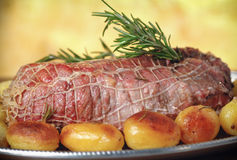 Roast beef  with roast potatoes Royalty Free Stock Photo
