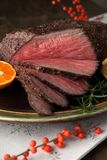 Roast Beef Rustic Style. Peppercorn roast beef with herbed Yorkshire puddings and gravy Stock Photos