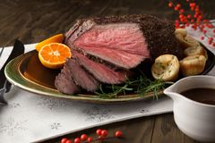 Roast Beef Rustic Style. Peppercorn roast beef with herbed Yorkshire puddings and gravy Stock Images
