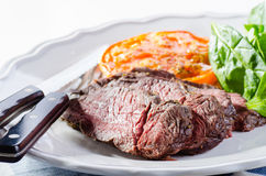 Roast beef with salad, roasted tomato and pepper sauce Royalty Free Stock Image
